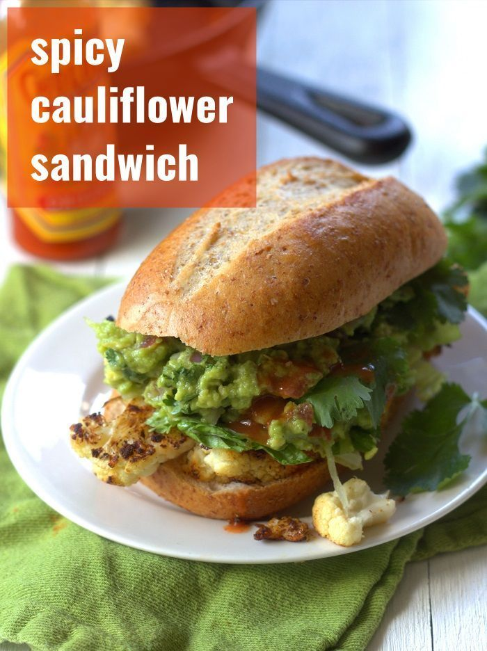 Spicy Cauliflower Sandwich Thick slabs of cauliflower are pan seared and roasted with spices before being stuffed into sandwich rolls with spicy guacamole in these sloppy...