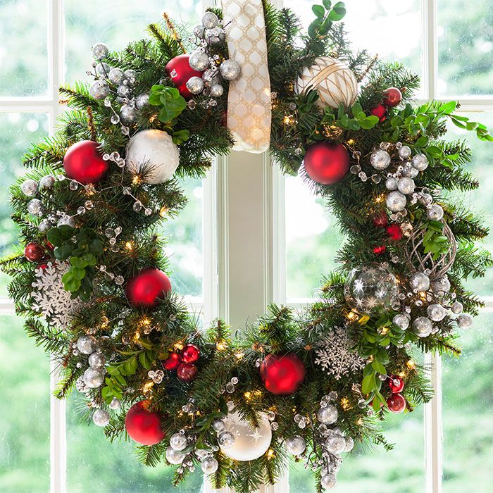 Christmas wreath with red and silvery balls and ornaments hung from