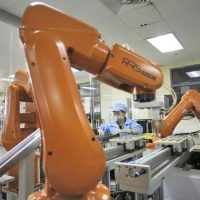 POPULAR - iPhone manufacturer Foxconn is replacing 60,000 workers with robots