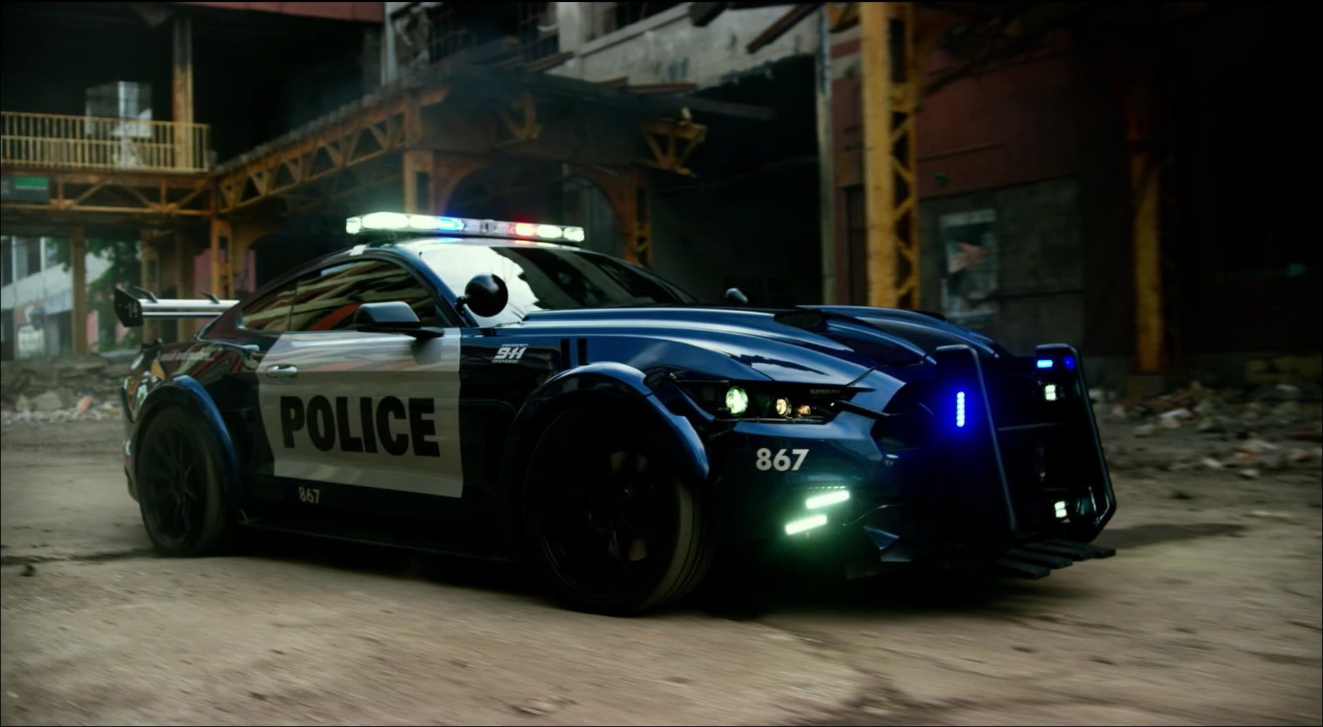 Blue And White Police Car Police Car Ford Transformers Ford Mustang Transformers The Last Knight 1080p Wallpaper Hdwallpa Mustang Ford Mustang Car Ford