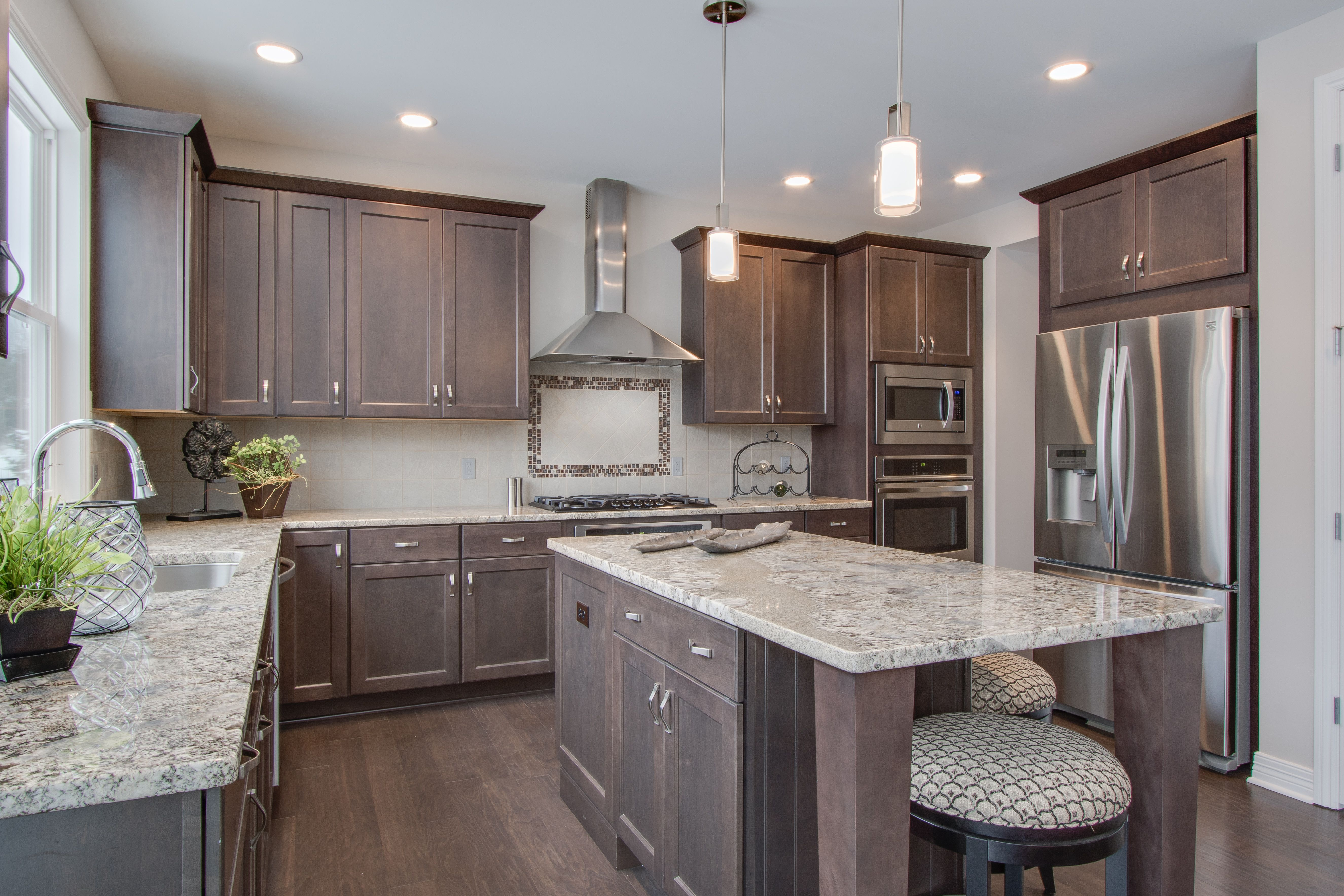Kitchen: Stained hardwood floors, cabinets, and island ...