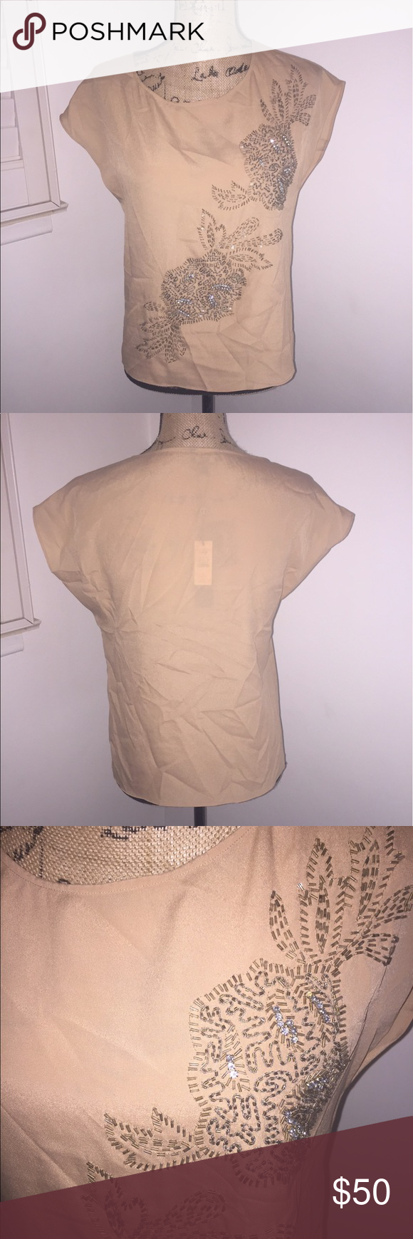 Talbots Top Brand new with Tags. Arm pit to arm pit is 20' and 22 1/2' from top to bottom. No stains or rips. Talbots Tops
