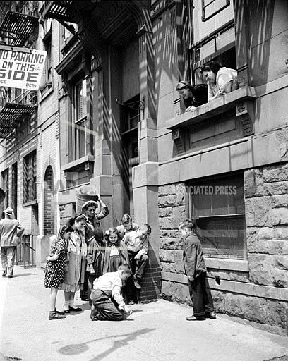amusing kitchen showroom new york city   NYC HELLS KITCHEN A young boy makes a chalk drawing on the ...