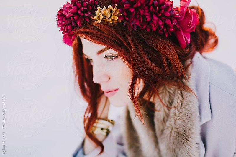 Red headed girl wearing flower crown looking away