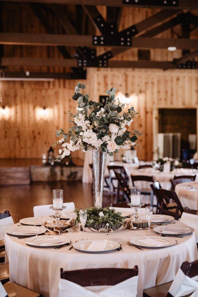 Natural wedding reception table decor A tall
