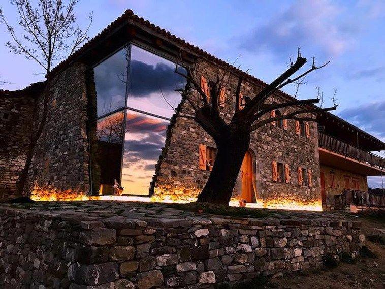 Striking Stone Farmhouse With Modern Glass