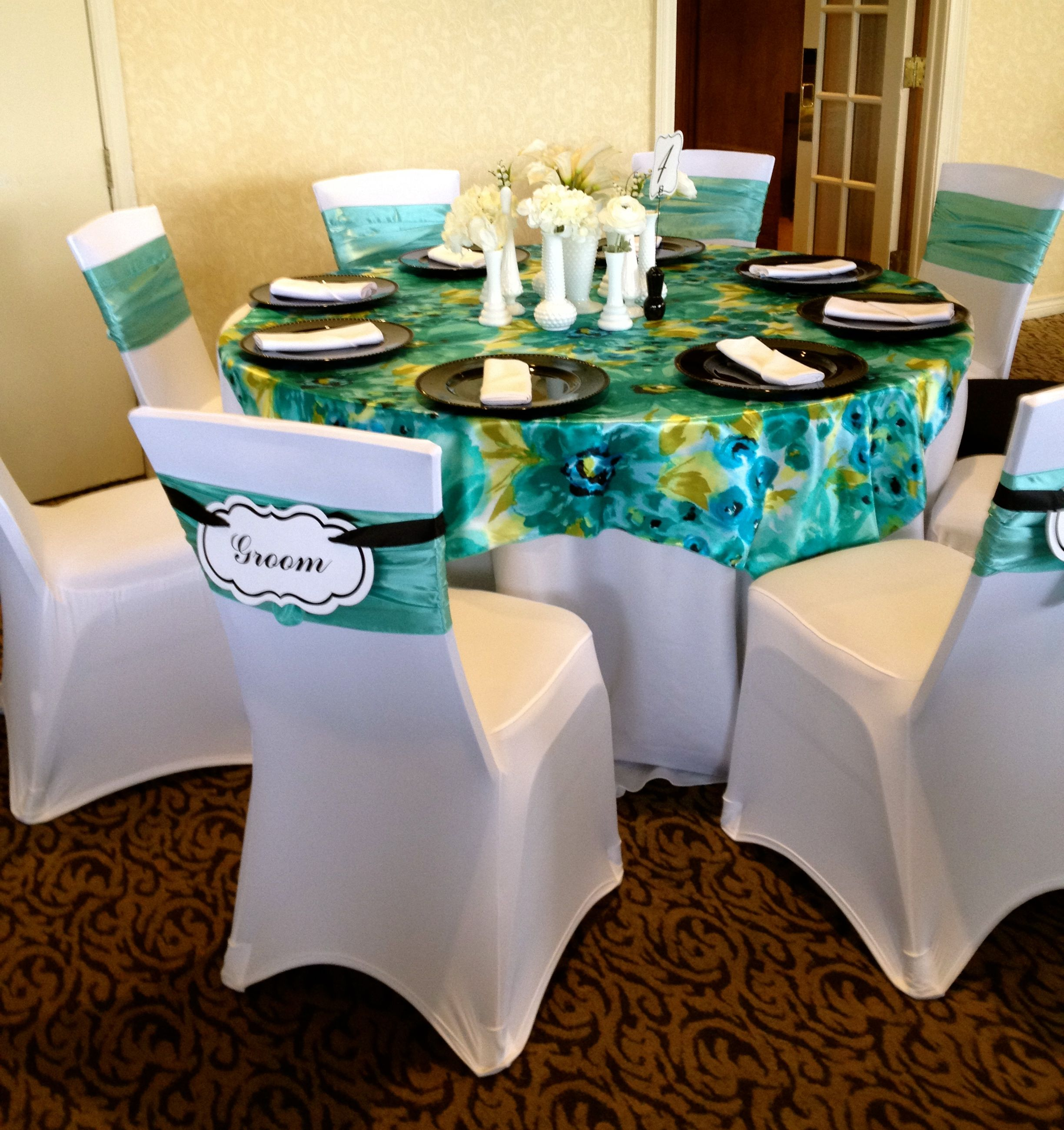 teal chair covers for wedding black hanging spandex are a new trend along with