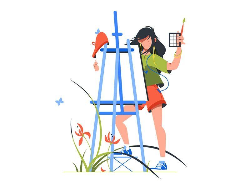 Woman artist holding paintbrush