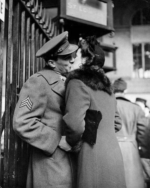Soldier kissing his girl goodbye at Pennsylvania Station photographed by Alfred Eisenstaedt, 1944.
