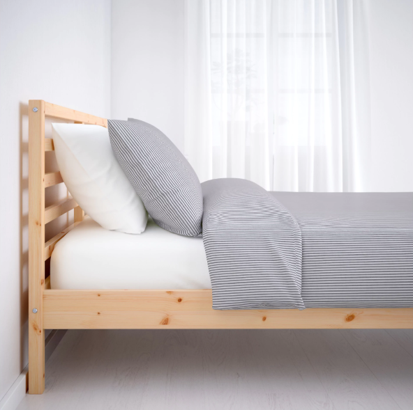 Side View Of Simple Pine Bed With Grey Sheets Pinebeds Bed