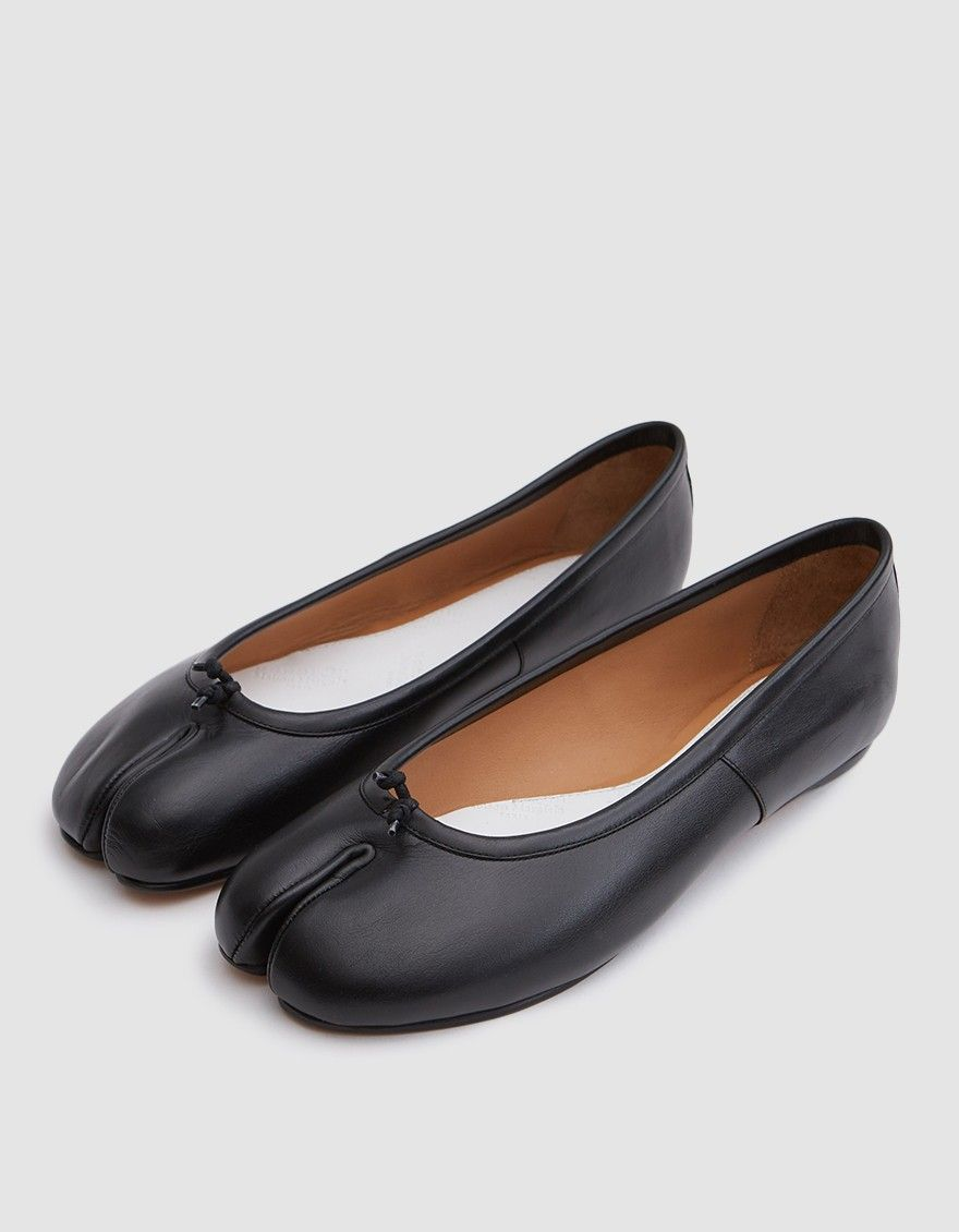 983b6074e3a4 Tabi ballerina flats from Maison Margiela in Black. Brushed calfskin upper.  Iconic split toe. Signature white stitch at heel. Lightly padded footbed.