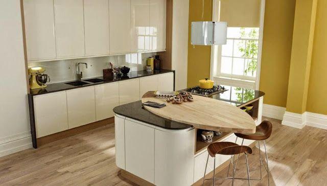 Barra integrada en la isla de cocina, en madera, un material muy ...