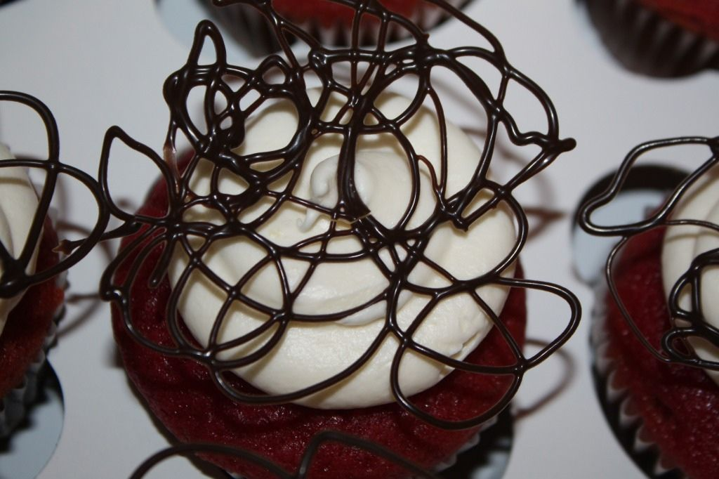 Red velvet cupcakes with elegant chocolate toppers