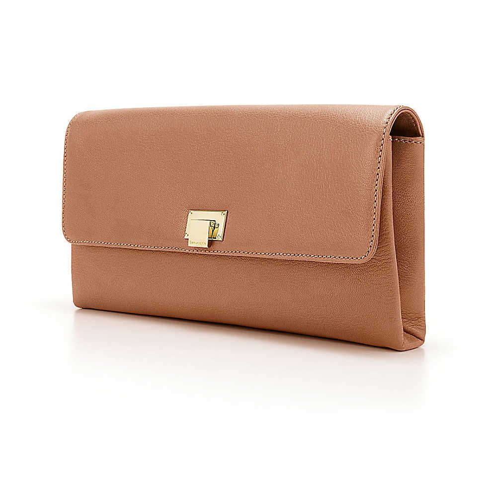 Piper clutch in cognac smooth leather. More colors available.   Tiffany & Co.