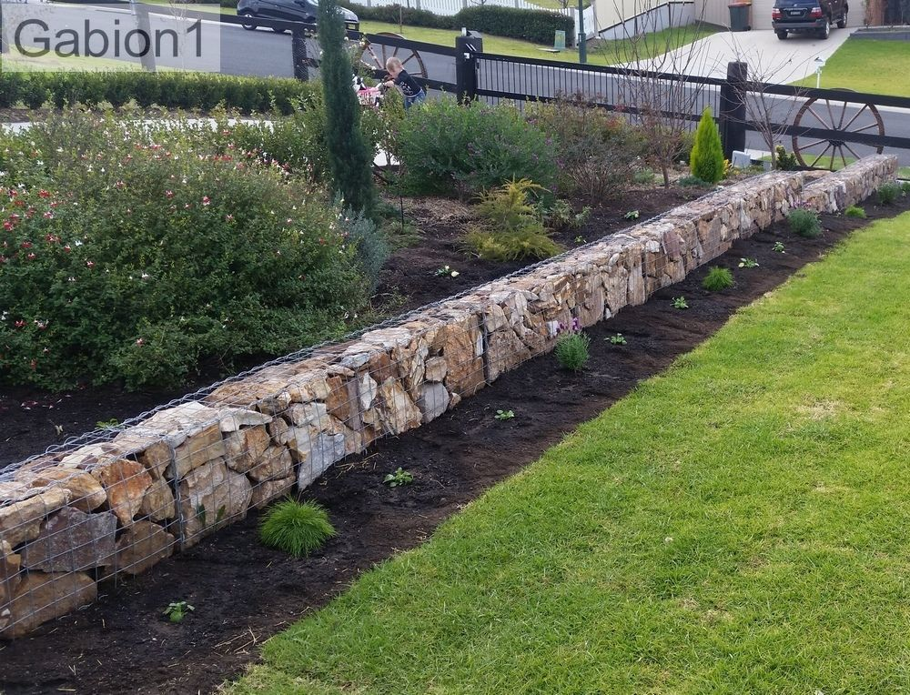 low gabion wall as garden border. Black Bedroom Furniture Sets. Home Design Ideas