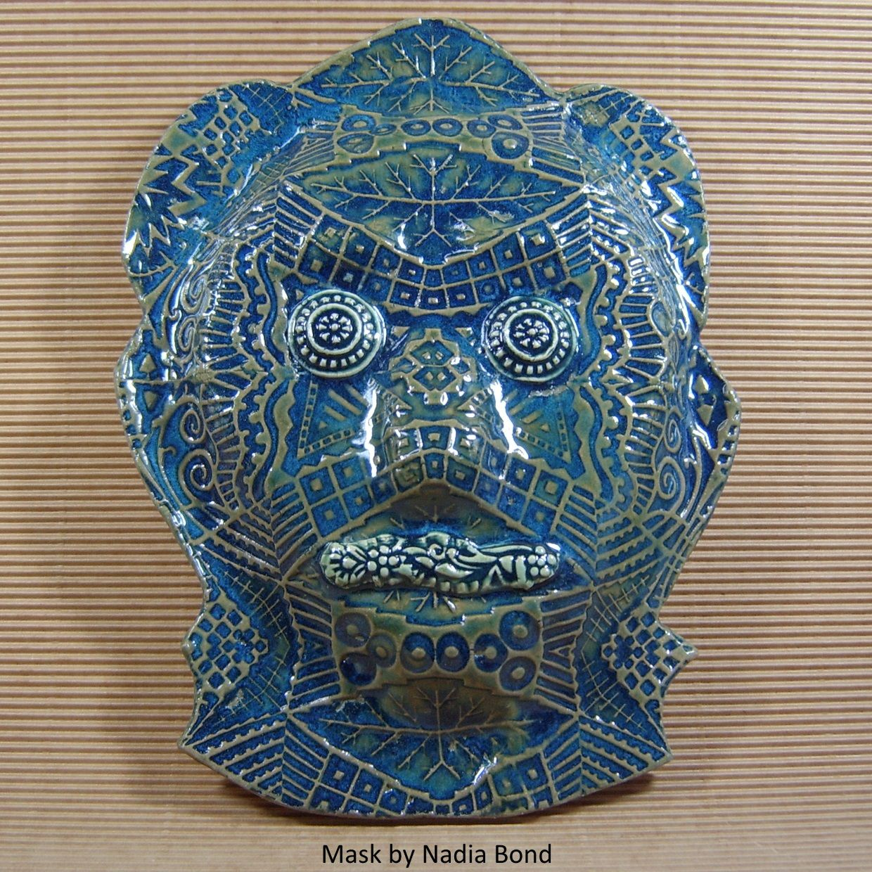 Nadia Bond's mask, MICHABO, for the 2016 Faces of Value Fundraising Gala, Collingswood, NJ. Amaco Midnight Blue glaze, lifted with a dip in Oribe afterwards. Michabo is the American Indian God of Many Things.