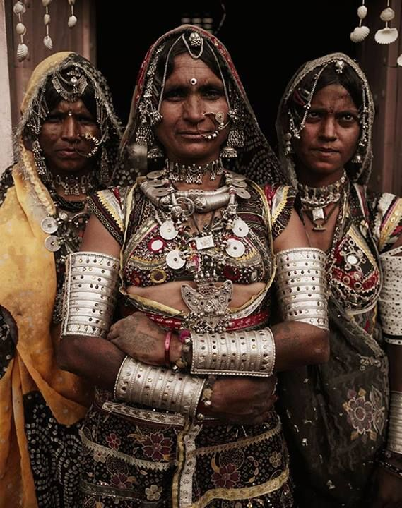 Women of the Rabari tribe in Rajasthan, India, posing in traditional finery for a photograph by Jimmy Nelson, who is making a big impact with material on show as a result of his new book *Before They Pass Away*, purportedly providing a snapshot of remote tribes as they are, currently.