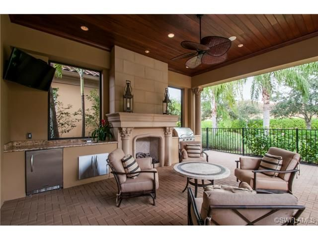 Covered Lanai Wood Ceiling Fireplace And Summer Kitchen Grey Oaks In Naples Fl Florida Home Outdoor Living Space Living Spaces
