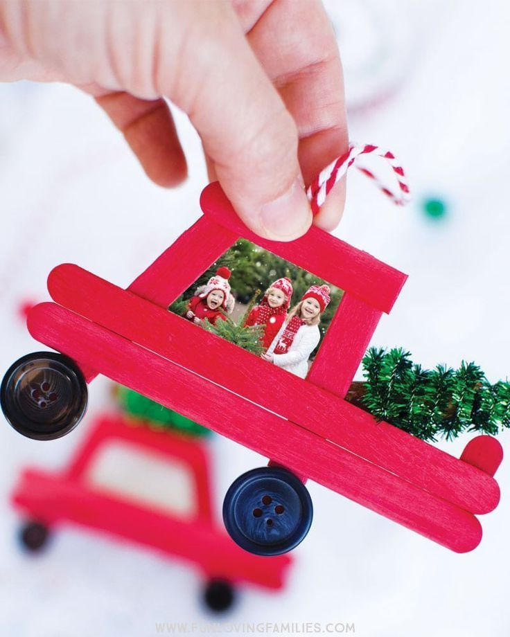 Make this adorable DIY popsicle stick Christmas truck and add a special holiday photo. Fun Christmas craft and family keepsake ornament. #christmas #diychristmasornaments #handmadeornament #popsiclestickornament #christmascrafts #funlovingfamilies
