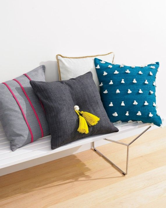 For a fun, easy project, add your personal flair to store-bought pillows. You can sew a chain trim to the edges, affix an oversized double tassel to the dimpled center, or sew tassels to the back side.