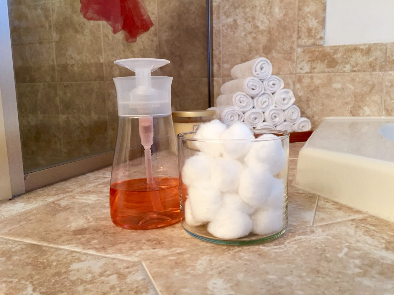 reusing a Windex Touch-Up Cleaner bottle for nail polish remover and a Bath and Body Works candle jar for cotton balls. reduce, reuse, recycle!
