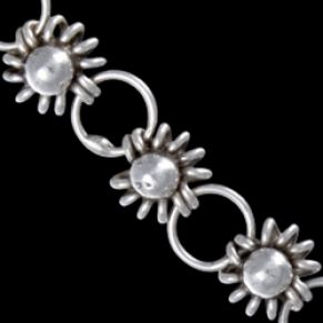 Sterling silver bracelet. Exquisite bracelet style of flowers alternating with round links.