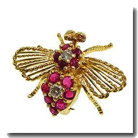 Cartier ruby and diamond bee pin.