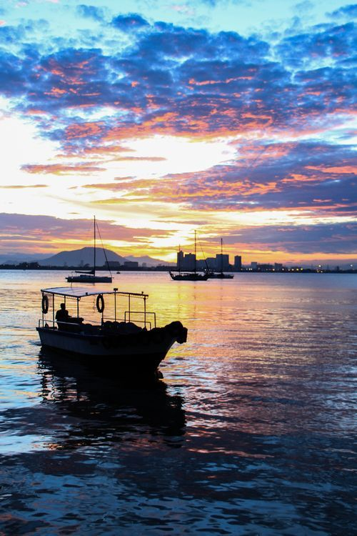 Chew jetty's sunrise Photo by w. lim -- National Geographic Your Shot