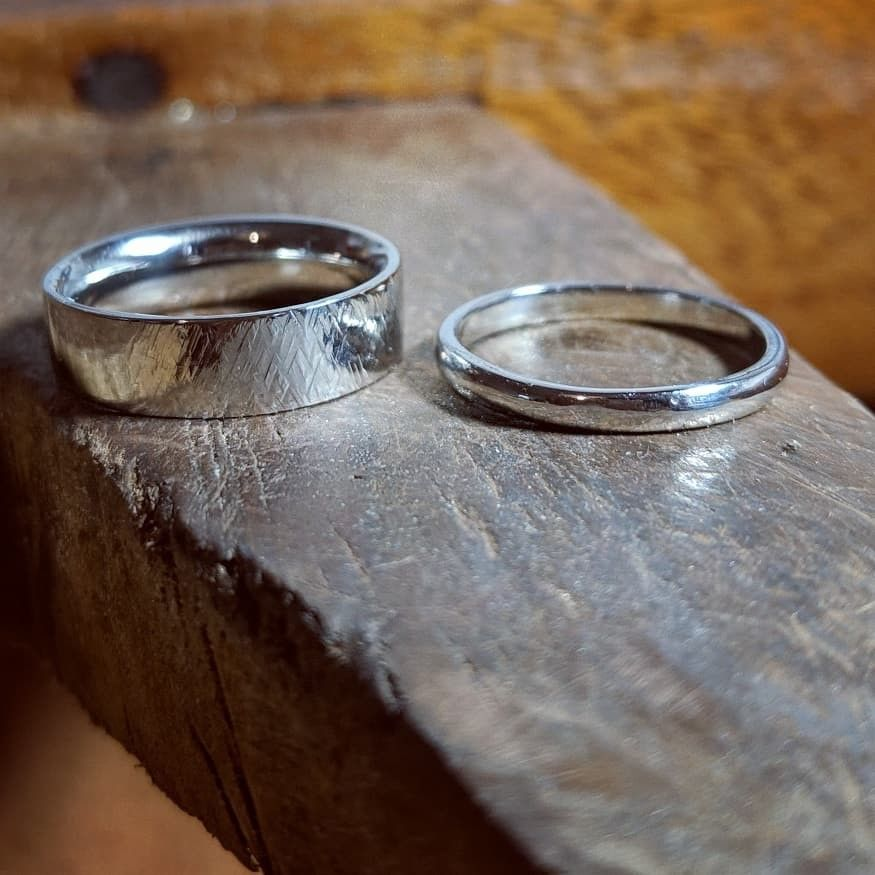 A Pair Of Platinum Wedding Rings Recently Finished By One Of