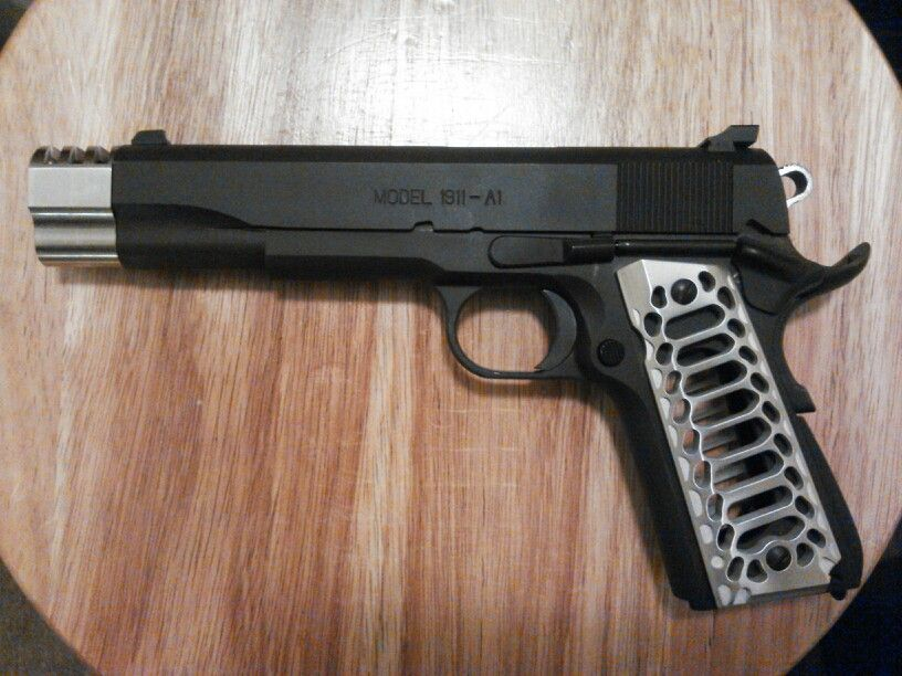 Springfield 1911 with Valkyrie Dynamics grip and compensator