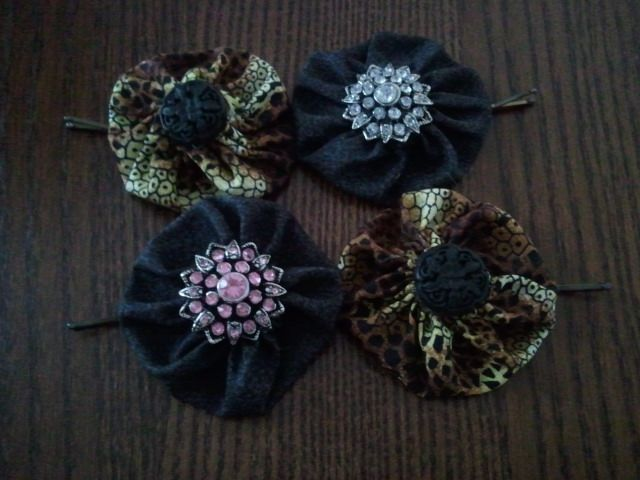 I really enjoyed following the directions and making these hair clips.  The tutorial was super easy and this is an inexpensive craft.  It cost less than $1.00 if you use buttons or things you already have for the centerpiece. It takes less than 10 minutes.