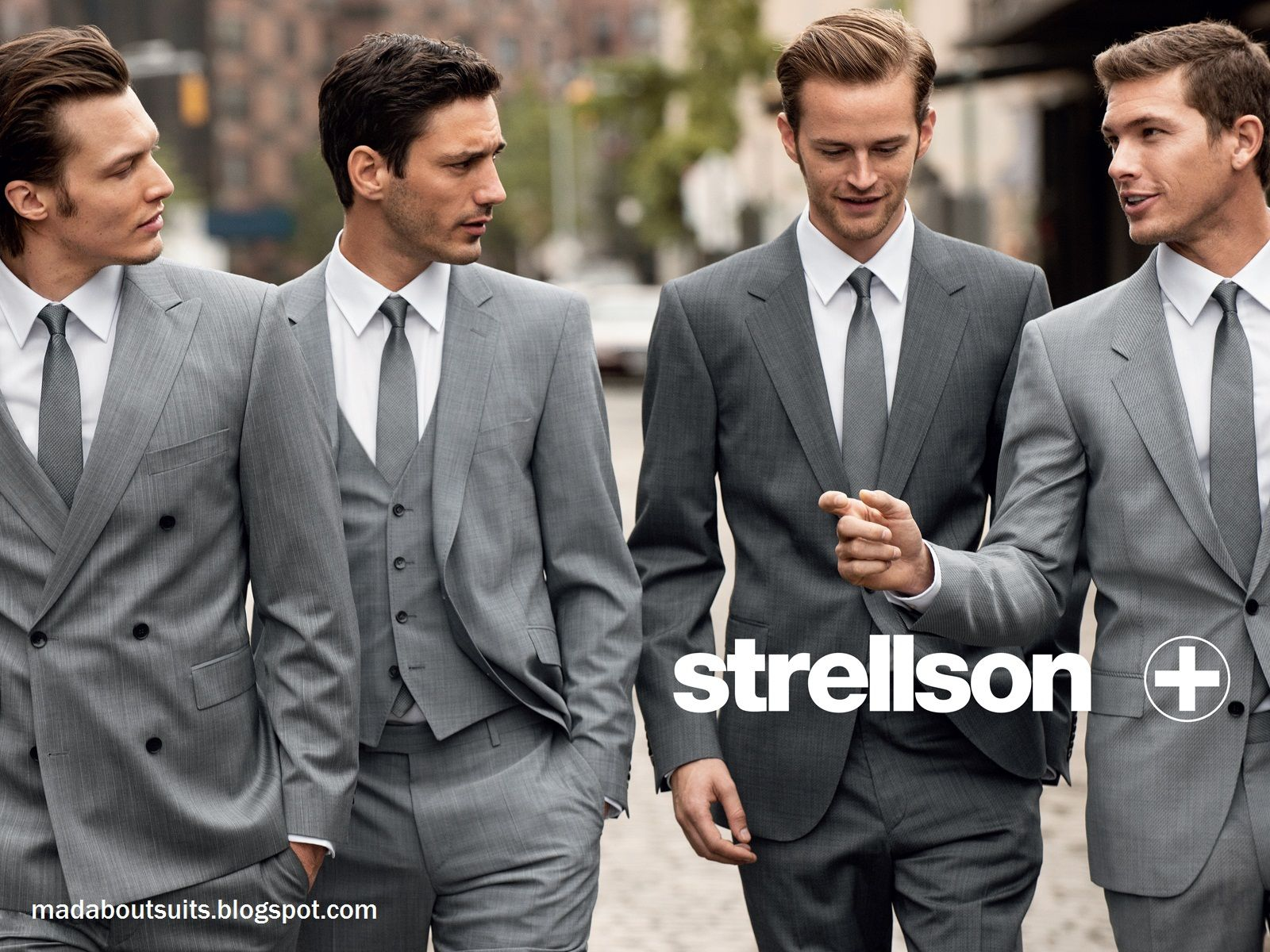 b5fe83169 Groomsmen in light gray, groom in darker gray. Very attractive wedding  party. Plus I love the style of the suits