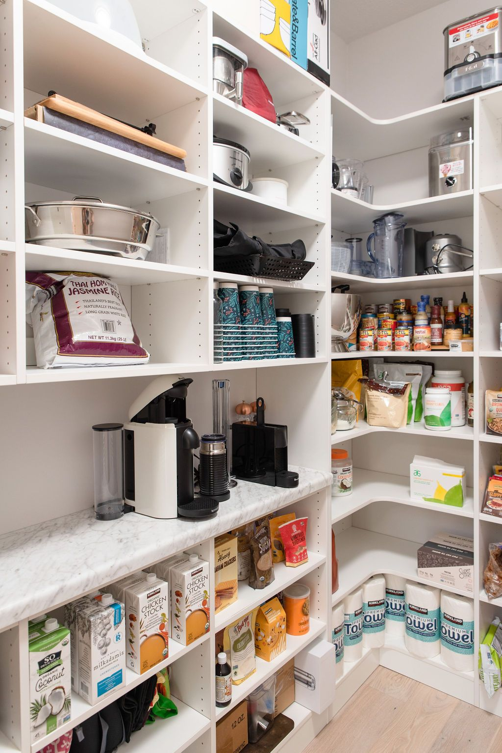Walk-in pantry with laminate marble style shelf for coffee bar/station