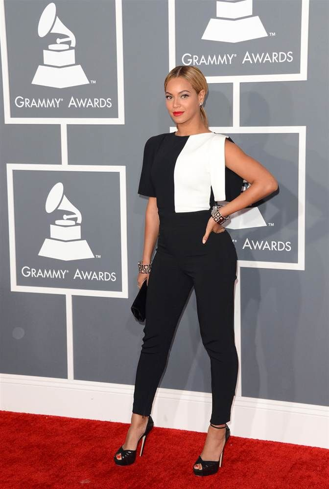 75ba2686a296 Beyonce strikes a pose in a black jumpsuit by Osman and a Swarovski clutch.  (Photo  Jason Merritt   Getty Images)  Grammys