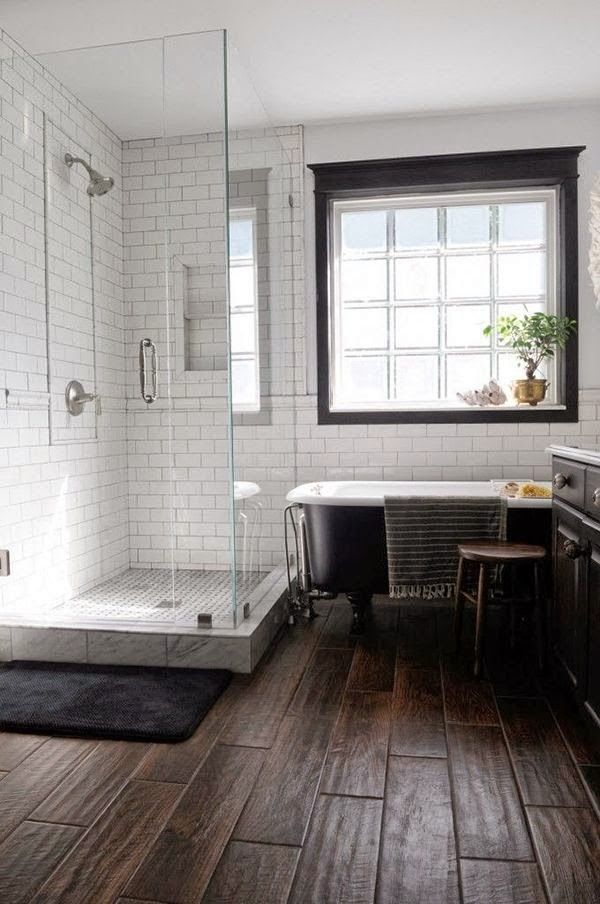 wood tile floor, white subway tile with dark grout, black window ...