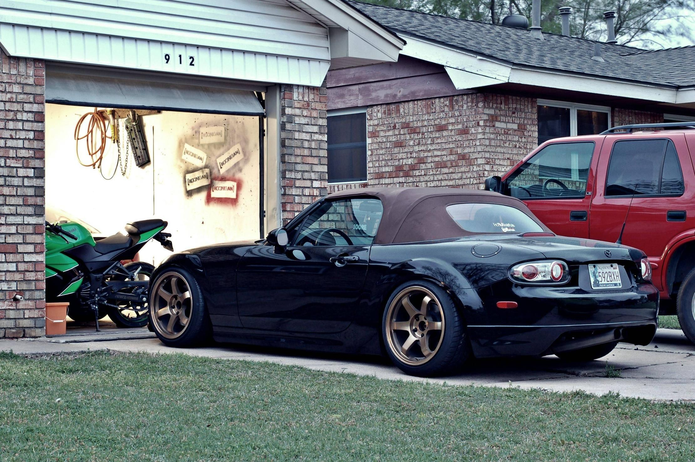 NC Miata But that motorcycle in the garage though Vroom