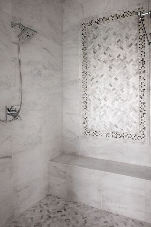 Amazing Master Shower Features Carrera Marble Tiled Surround Accented With A Mosaic Inset Tiles Above Bench And