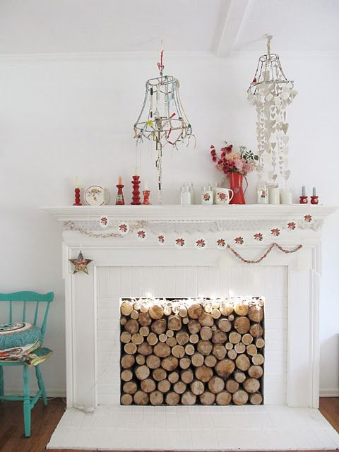 Chopped wood logs stored in fireplace, especially if fireplace is ...