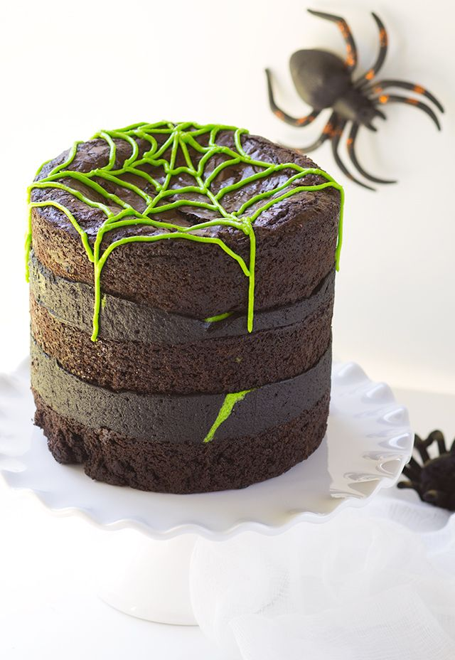 Spider Egg Brownie Cake - three layers of brownie stuffed with cadbury screme eggs (spider eggs). It's then filled with a mixture of chocolate and vanilla frosting!