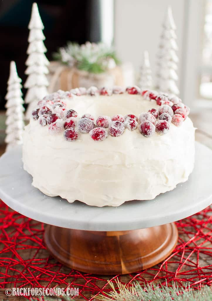 This Fresh Cranberry Christmas Cake will fill you with Christmas cheer! Topped with the best cream cheese frosting and garnished with sugared cranberries! #cranberrychristmascake This Fresh Cranberry Christmas Cake will fill you with Christmas cheer! Topped with the best cream cheese frosting and garnished with sugared cranberries! #cranberrychristmascake