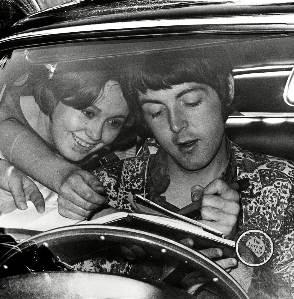 Paul McCartney signing autographs in his Aston Martin, June 18,1967. Photo by David Gerrard.