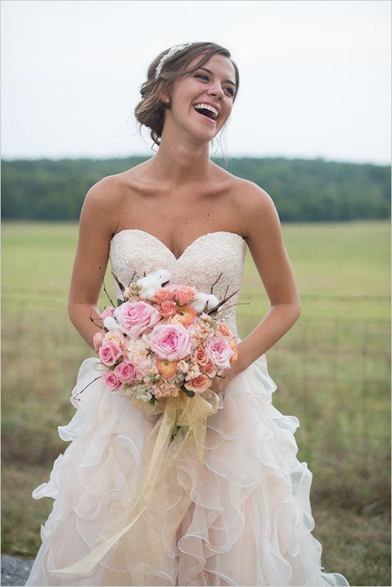 Romantic Bridal Attire With Pink Bouquet