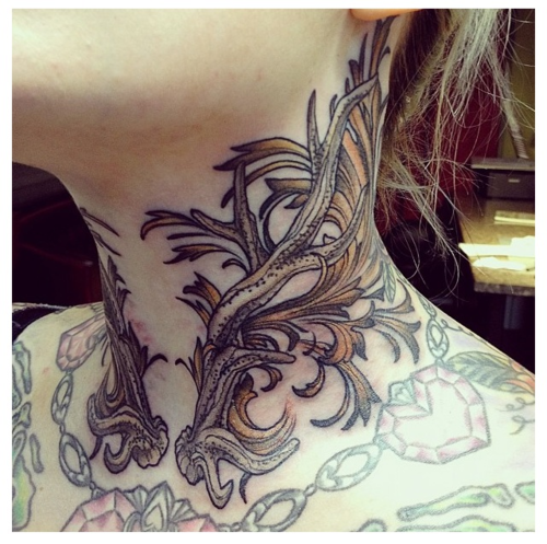 Placement and work is perfect. <3  This artist, I must find!  fuckyeahgirlswithtattoos.tumblr.com