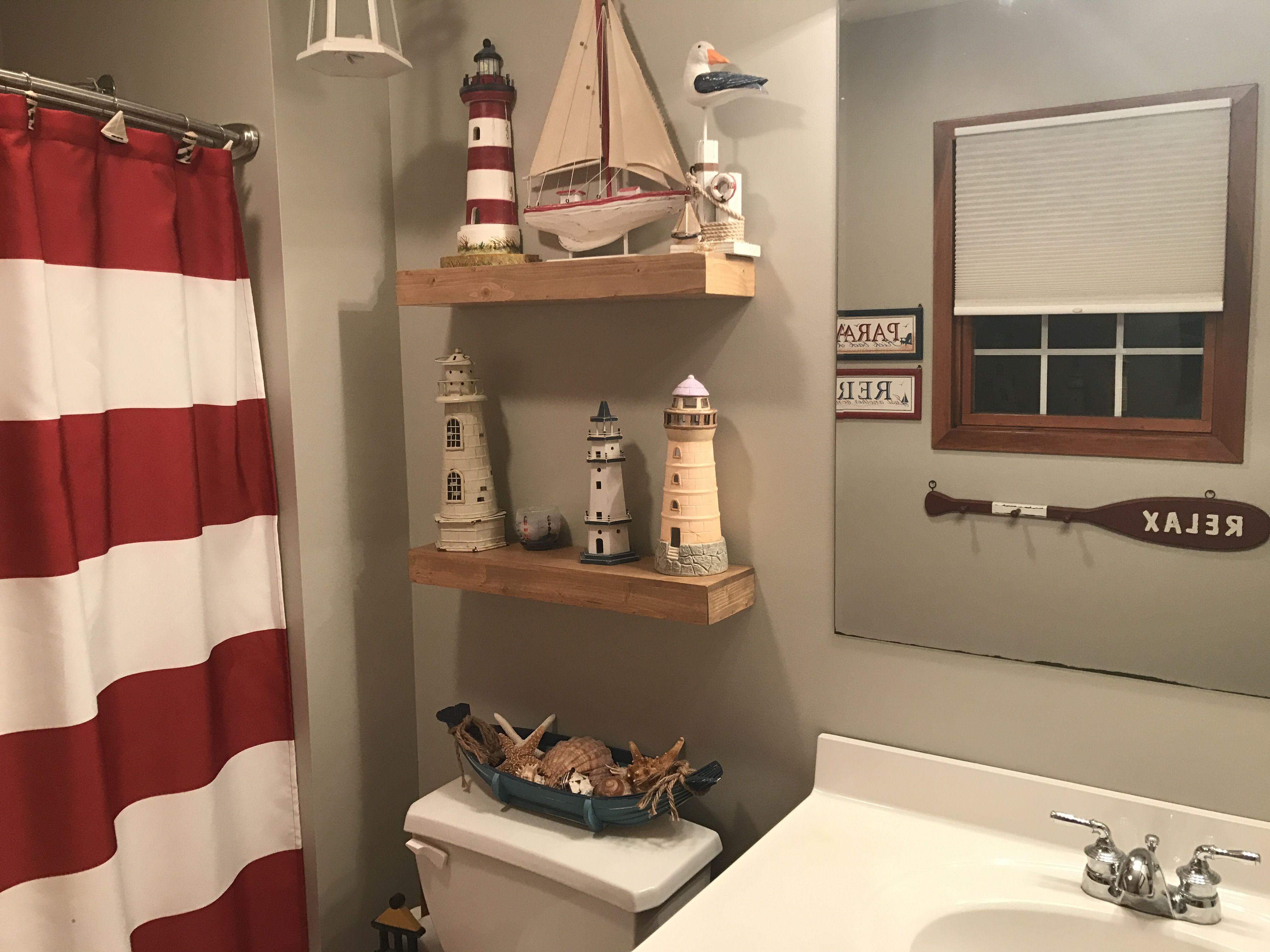 Lighthouse theme in bathroom.  Restroom decor, Pirate bathroom