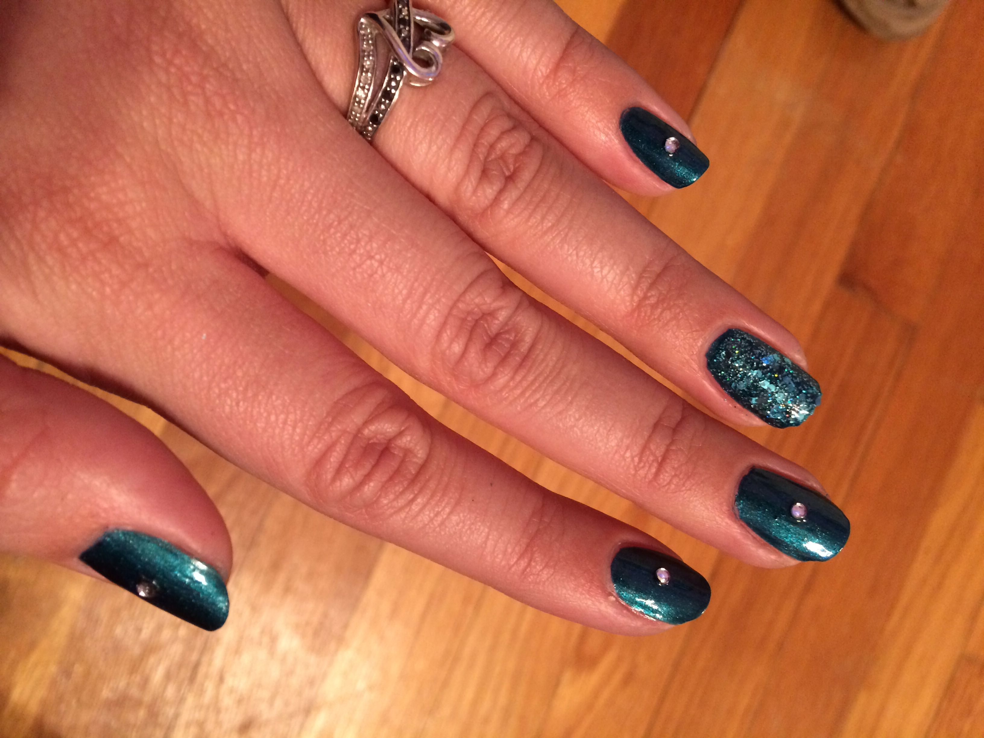 """Sephora OPI """"Teal We Meet Again"""" and Sephora OPI """"Not Your Average Turquoise"""". Also a little gem in the middle of the nails."""
