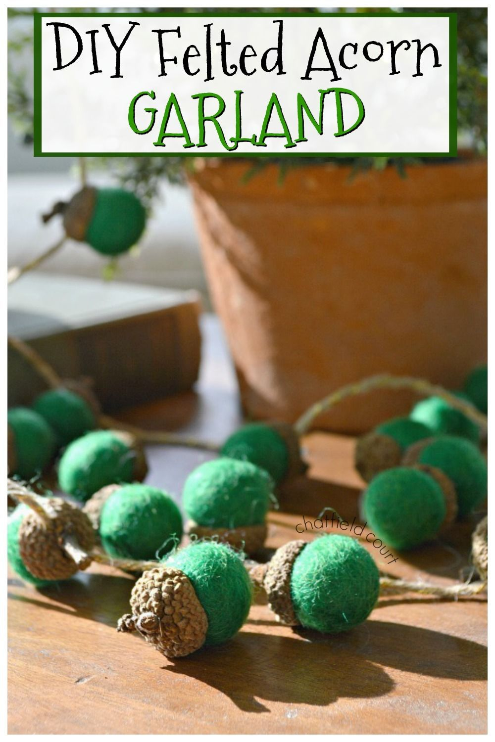 How to make DIY felted acorn garland to add to your holiday decor. Such an easy, and thrifty, Christmas craft using acorns found in the yard and felted wool balls.