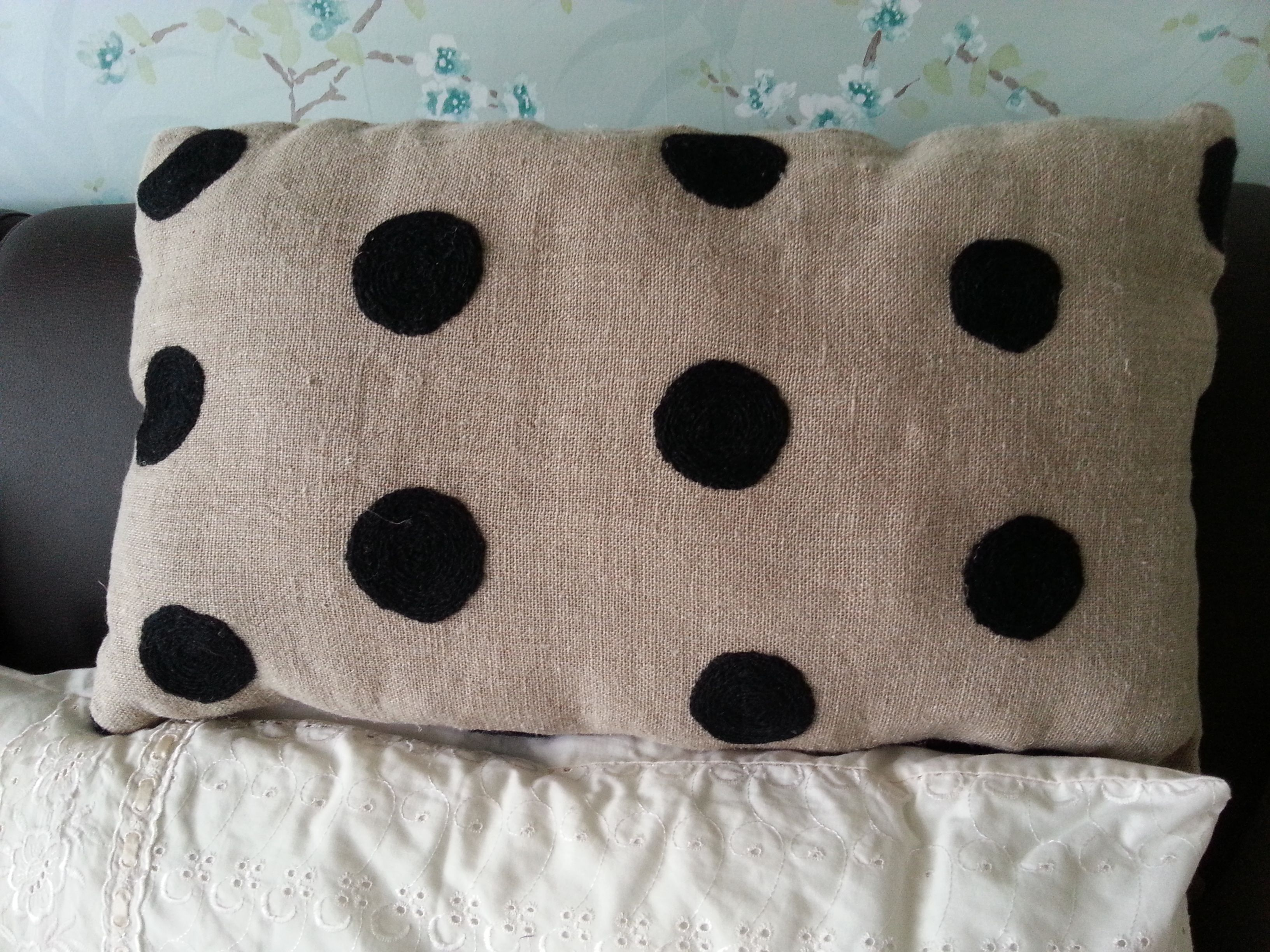 Handmade oblong cushion using a dark beige hessian type material