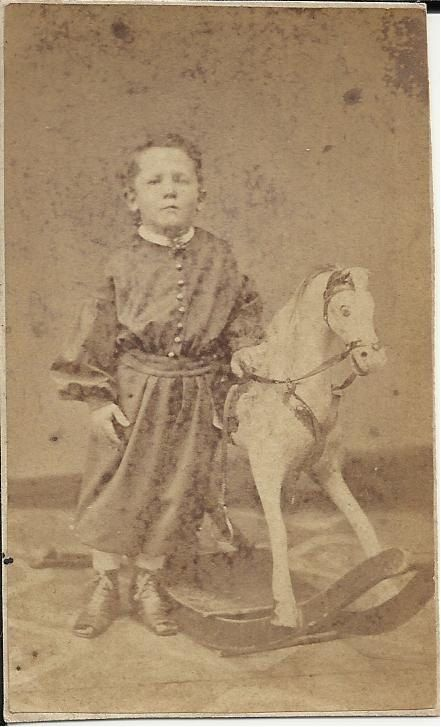 1860s CDV of a boy with his rocking horse.