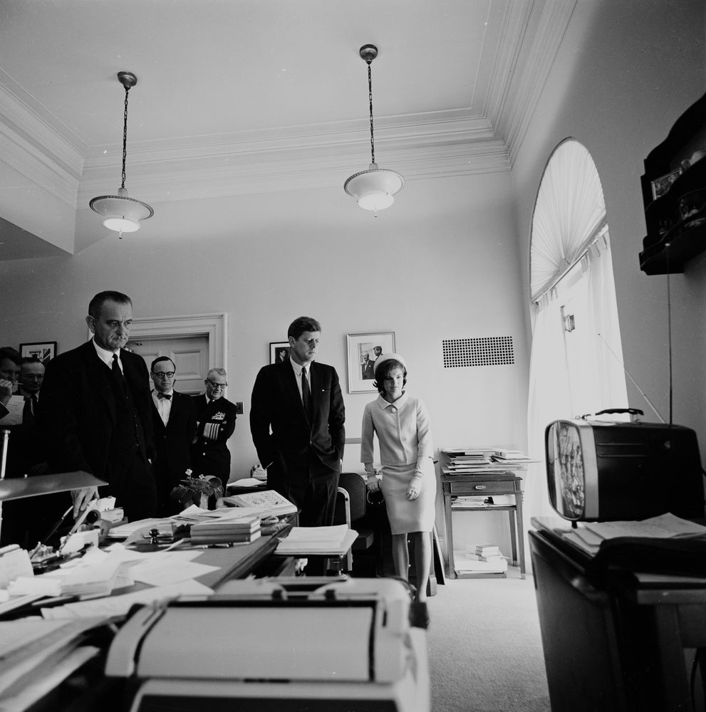 President John F. Kennedy, Jacqueline Kennedy, Lyndon B. Johnson, and others watch the lift-off of the FIRST American in Space, Astronaut Alan Shepard.  -from the JFK Library