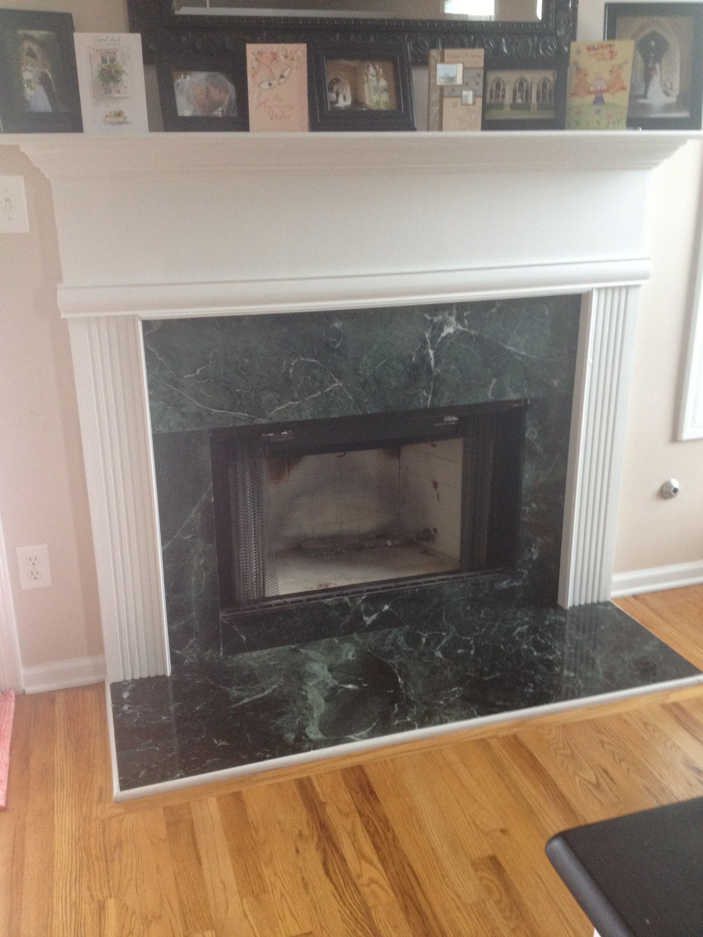 Before pic of the Annie Sloane fireplace green marble